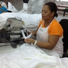 """Aracelis Upia Montero works at the Alta Gracia garment factory in the Dominican Republic. She says she was desperately poor before she began working at the factory, which pays much higher than usual wages. """"I'm now eligible for loans and credits from the bank because I earn a good salary,"""" she says."""