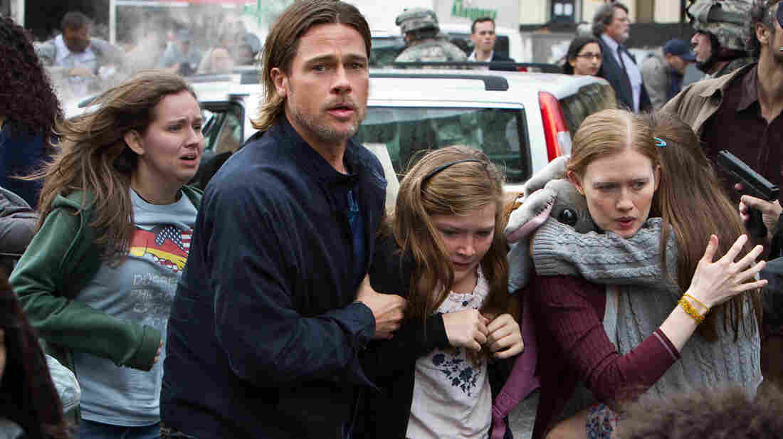 Brad Pitt is Gerry Lane, Abigail Hargrove is Rachel Lane, and Mireille Enos is Karin Lane in World War Z.