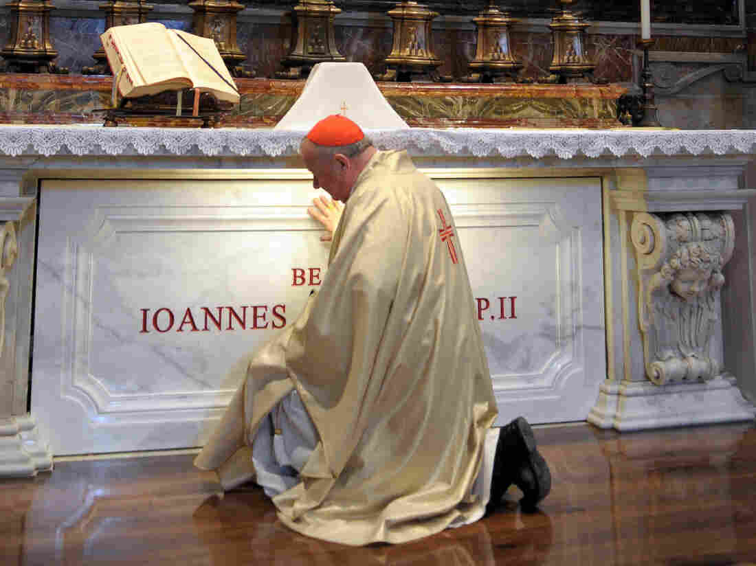 Cardinal Stanislav Dziwisz, archbishop of Krakow and former personal secretary of Pope John Paul II, prays in front of the late pope's tomb at St. Peter's Basilica in 2011, in Vatican City.