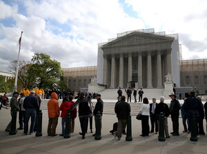 People line up to enter the Supreme Court building on April 22, when the court heard arguments in the Agency for International Development v. Alliance for Open Society International case.