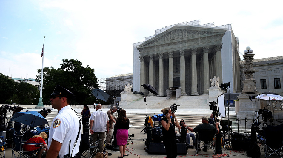 Members of the media wait for court rulings in front of the U.S. Supreme Court building on Monday. (Getty Images)