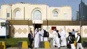 Guests arrive for the opening ceremony of the new Taliban political office in Doha on June 18.