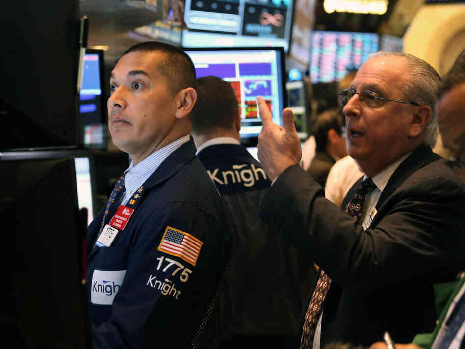 Traders work the floor of the New York Stock Exchange after the opening bell on