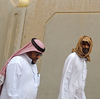 Saudi men walk to the King Fahad hospital in the city of Hofuf on Sunday. In eastern Saudi Arabia, where outbreaks of the MERS virus have been concentrated, people have resumed their habits of shaking hands and kissing.