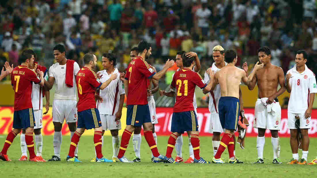 Players from Tahiti (in white) and Spain shake hands after their FIFA Confederations Cup match Thursday. Spain won, 10-0, but the Tahiti team, ranked 138th in the world, remains a fan favorite.