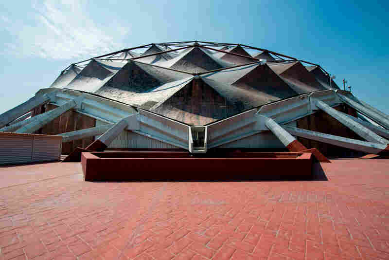 The Sports Palace, Mexico City. Designed by architects Felix Candela, A. Peyri and E. Castaneda Tamborell, the Sports Palace features an iconic copper-sheathed roof. It's still used for events and concerts today, but apparently the roof leaks.