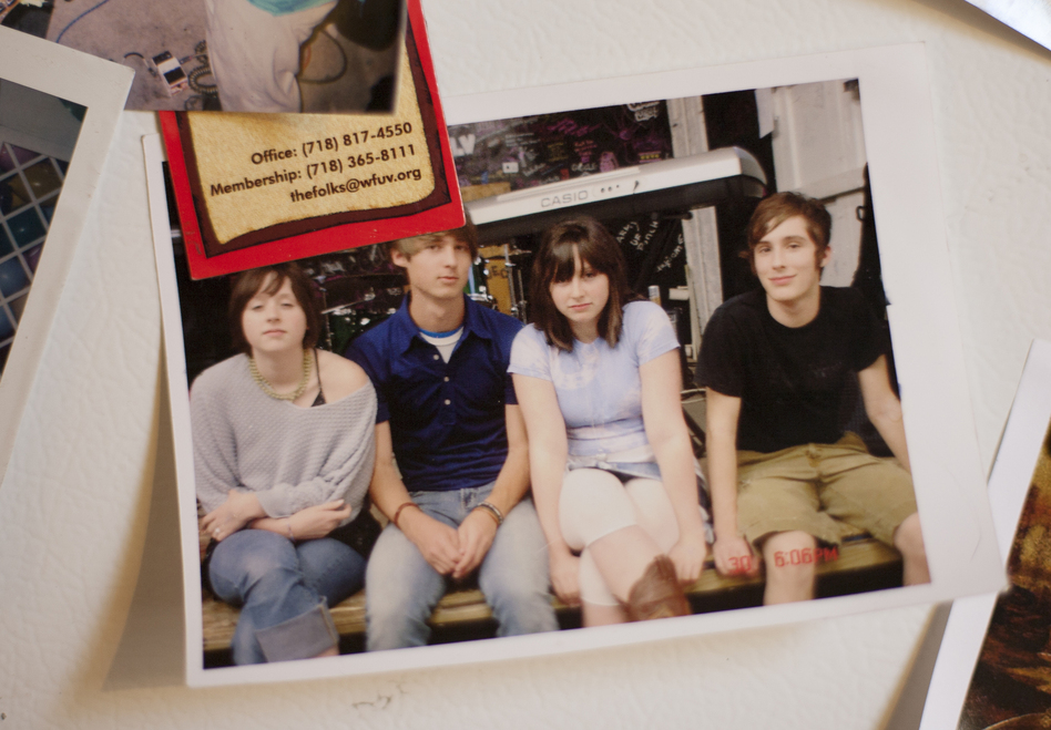 The Ackleys circa 2005, in a photo that now hangs on the Crutchfield sisters' refrigerator. Left to right: Allison Crutchfield, Michael McClellan, Katie Crutchfield, Carter Wilson. (Will Figg for NPR)