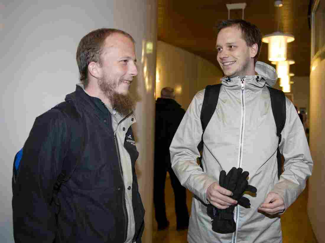 Pirate Bay co-founders Gottfrid Svartholm Warg (left) and Peter Sunde arrive at Stockholm's city court in 2009.