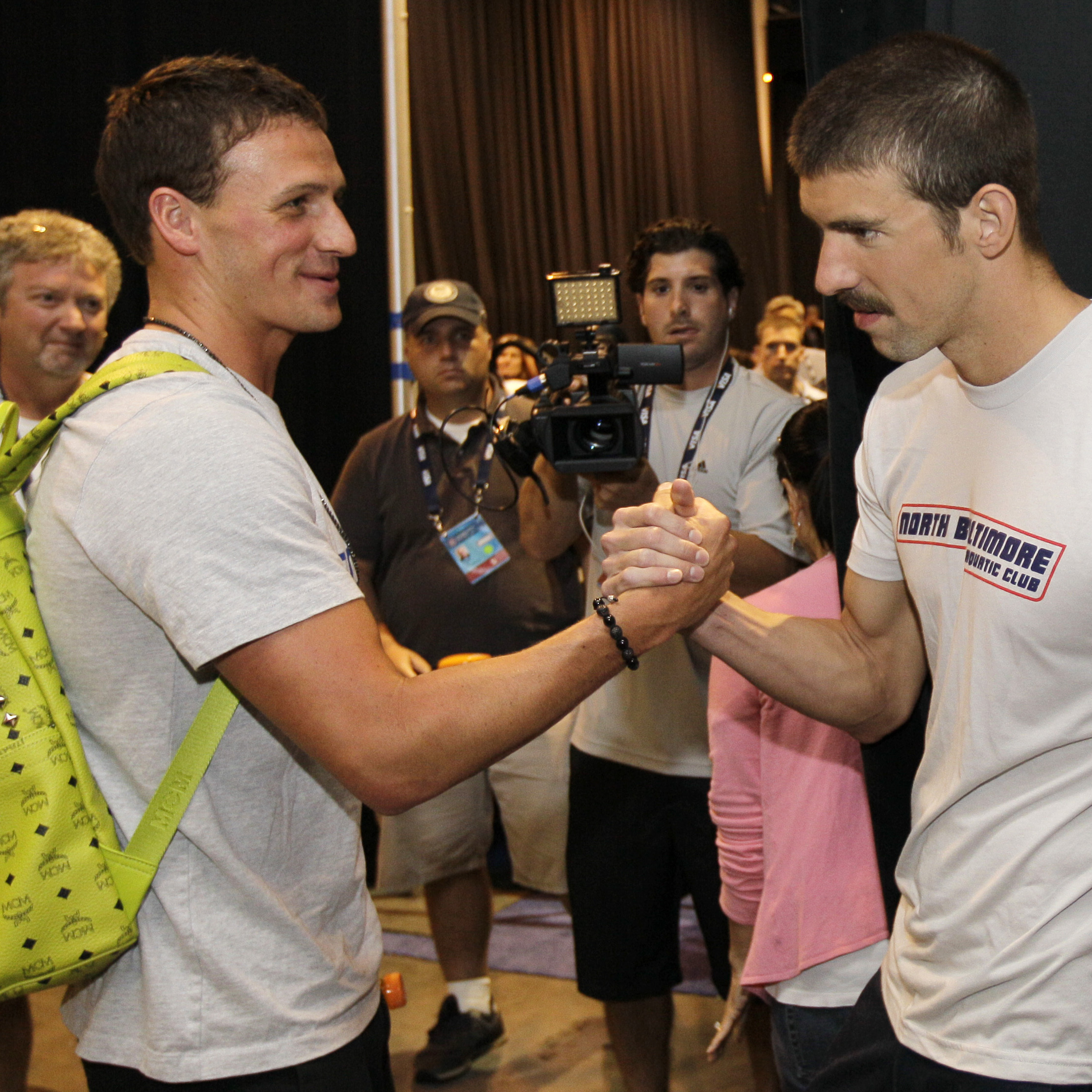 A beautiful bro-ment: Ryan Lochte and Michael Phelps give each other the traditional arm-wrestle bro-shake at the U.S. Olympic swimming trials in June 2012.