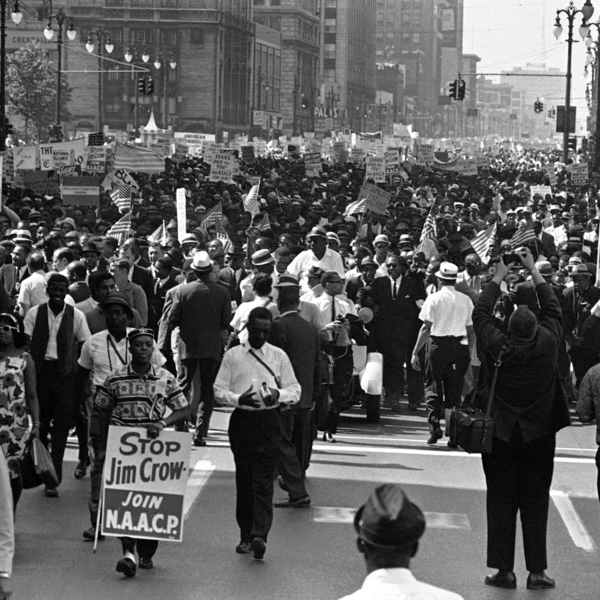 Martin Luther King, Jr., leads thousands of protesters along the streets of Detroit on June 23, 1963.