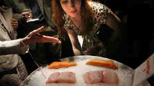 Jessica McConnell, 26, of Silver Spring, Md., tries to identify halibut, red snapper and salmon at a dinner hosted by Oceana and the National Aquarium in Washington, D.C.