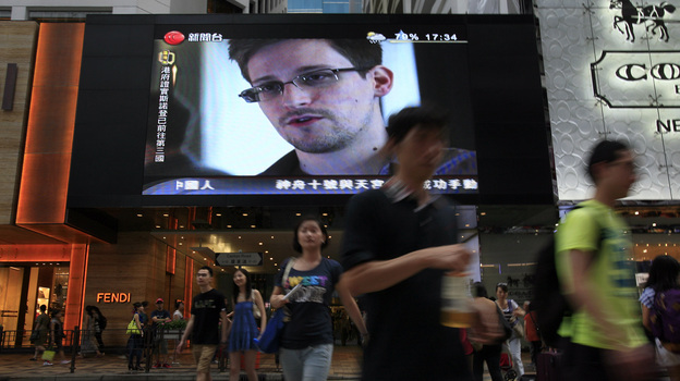 A TV screen shows a news report of Edward Snowden at a shopping mall in Hong Kong on Sunday. (Associated Press)