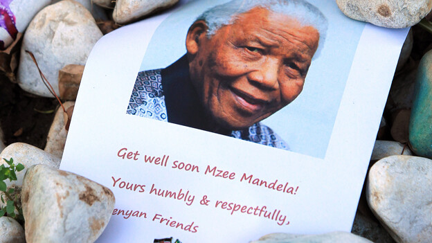 A print of Nelson Mandela and get well messages lay outside the home of the former President Mandela in Johannesburg, South Africa earlier this month. (Associated Press)