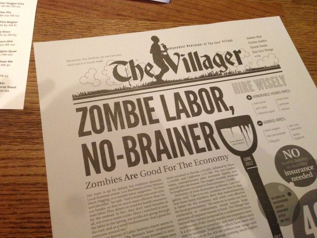 The menu at Zombie Burger is printed on the other side of a post-zombie-apocalypse newspaper.