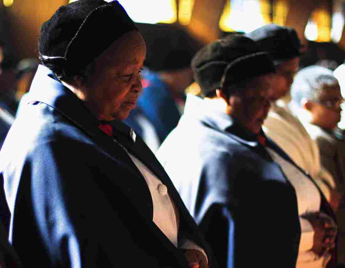 Prayers for Nelson Mandela: At Regina Mundi church in Soweto township, South Africa, on Sunday, congregants prayed for the former South African leader.