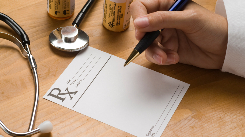 How does the doctor decide what to write on the prescription pad?