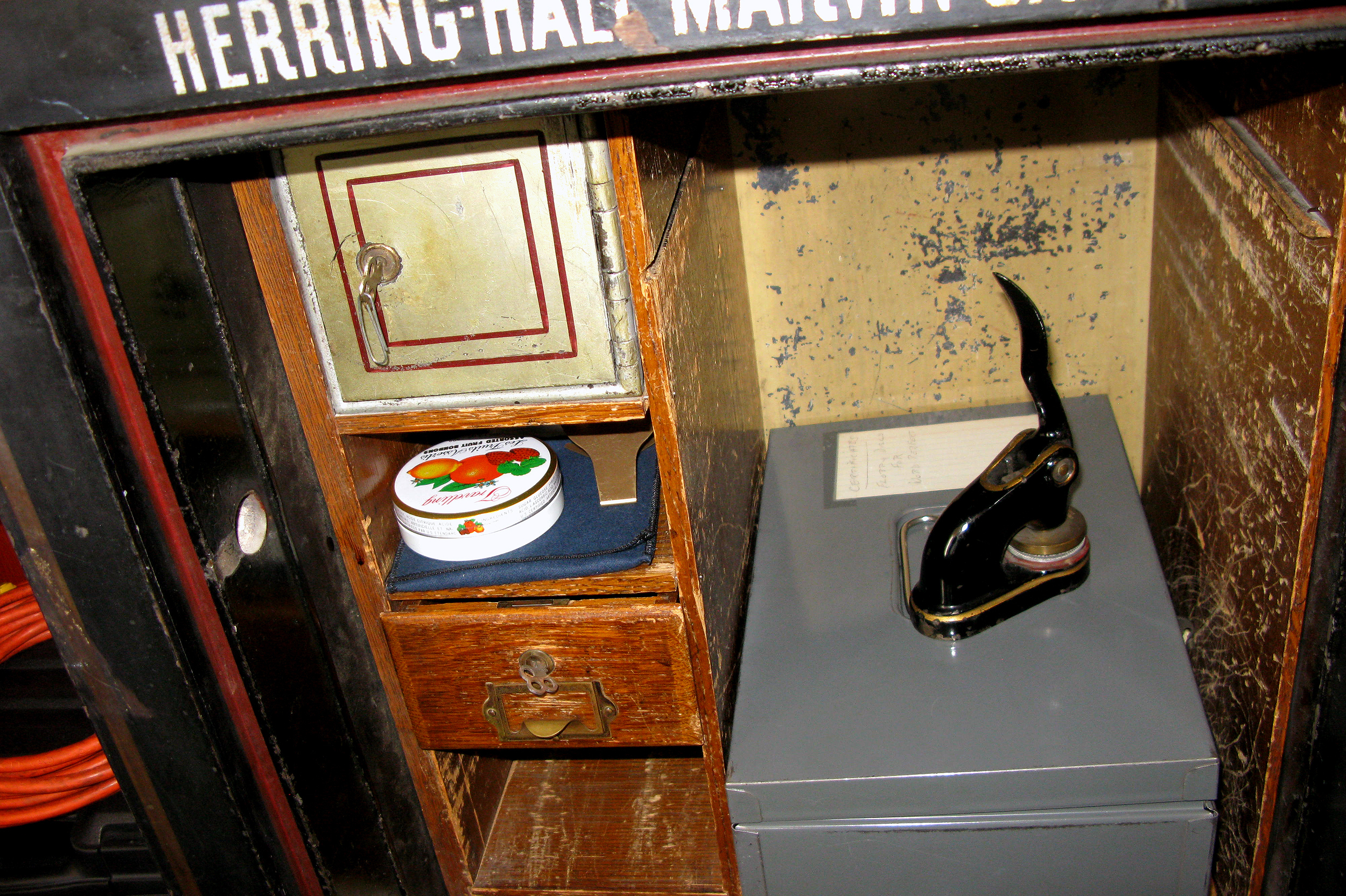 Among the many items inside the safe was a change purse filled with various world coins, a wooden stamp, documents from the 1930s, '40s and '50s, as well as a Smithsonian replica of the gavel originally used by Susan B. Anthony.