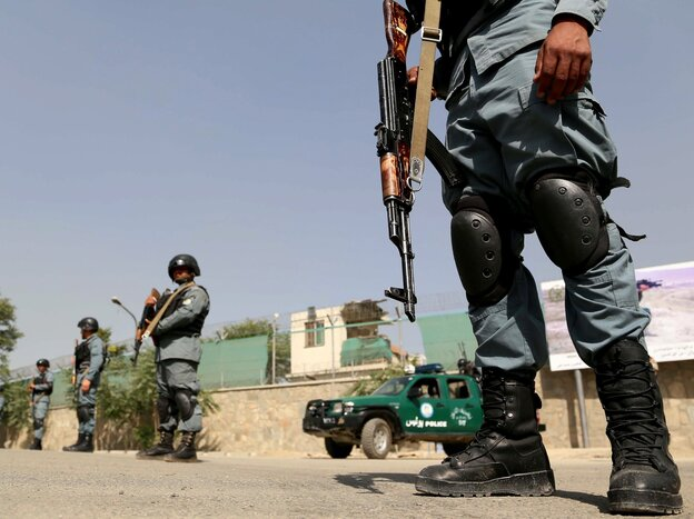 Afghan security officers at the scene of Tuesday's attack in Kabul.