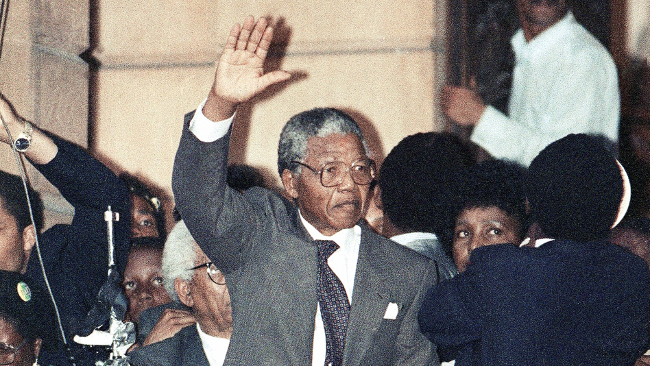 Several hours after his release from prison, Nelson Mandela made his first speech on the balcony of Cape Town's City Hall. As he prepared to speak, he realized he had left his glasses in the prison. So he borrowed a pair from his wife Winnie. (AP)