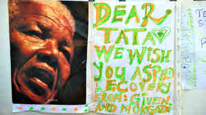 "A message for ""Dear Tata"" (Nelson Mandela) outside the hospital in Pretoria where he is being treated."
