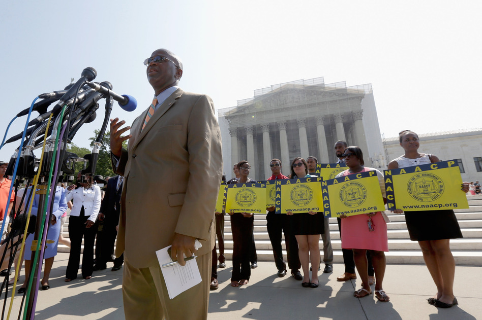 Field Director Charles White of the National Association for the Advancement of Colored People (NAACP) speaks at a podium outside the U.S. Supreme Court on Tuesday in Washington, D.C. (Win McNamee/Getty Images)
