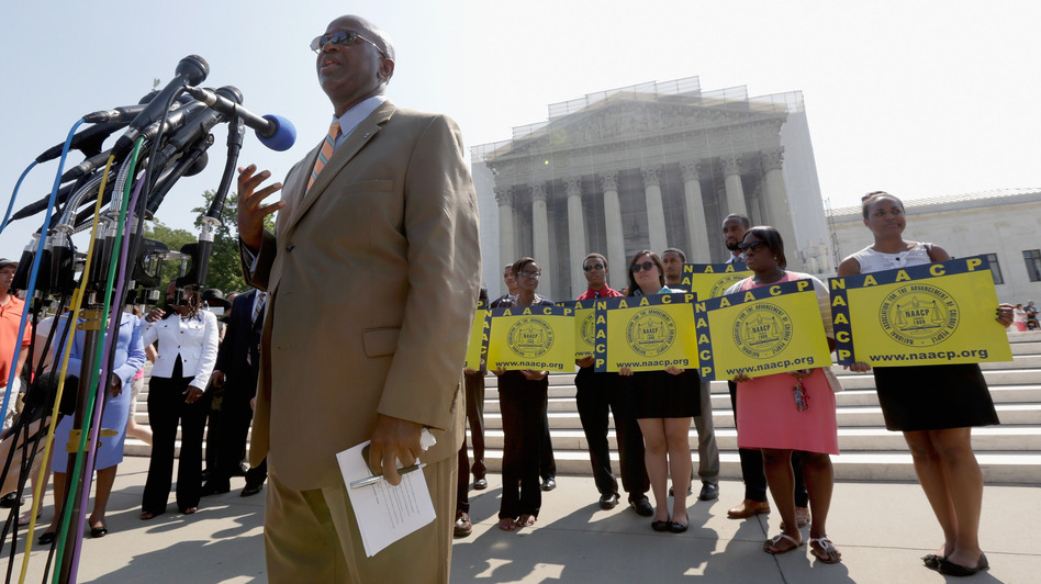 Field Director Charles White of the National Association for the Advancement of Colored People (NAACP) speaks at a podium outside the U.S. Supreme Court on Tuesday in Washington, D.C. (Getty Images)