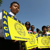 Supporters of the NAACP hold signs outside the Supreme Court building on Tuesday. The court ruled that Section 4 of the Voting Rights Act, which aimed at protecting minority voters, is unconstitutional.