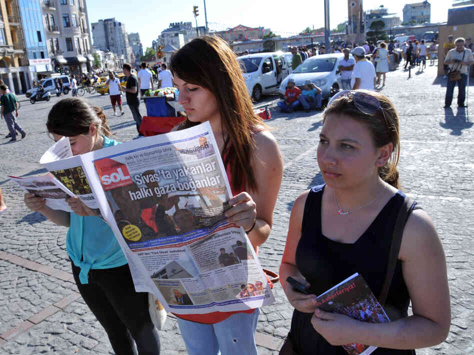 "Inspired by ""Standing Man"" Erdem Gunduz, protesters stand silently during an action at Istanbul's Taksim Square on June 23. Among the latest recommended reads from Tina Brown is a Foreign Affairs article on how Turkey's manipulates media coverage of political unrest."