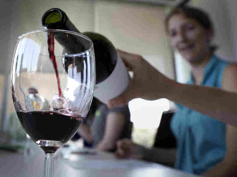 Swigging for science: A hint of oak, our wine tasting newbies learned, is more common in reds than whites. It's a marker for expense in both.