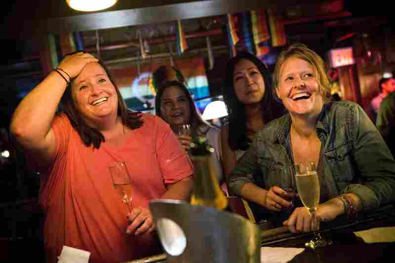 Rachel Howald, Kate Lummus, Virginia Sin and Gretchen Menter celebrate at the Stonewall Inn, in the West Village neighborhood of New York City, after the court's ruling. The Stonewall Inn played a key role during the gay rights movement of the 1960s and 1970s.