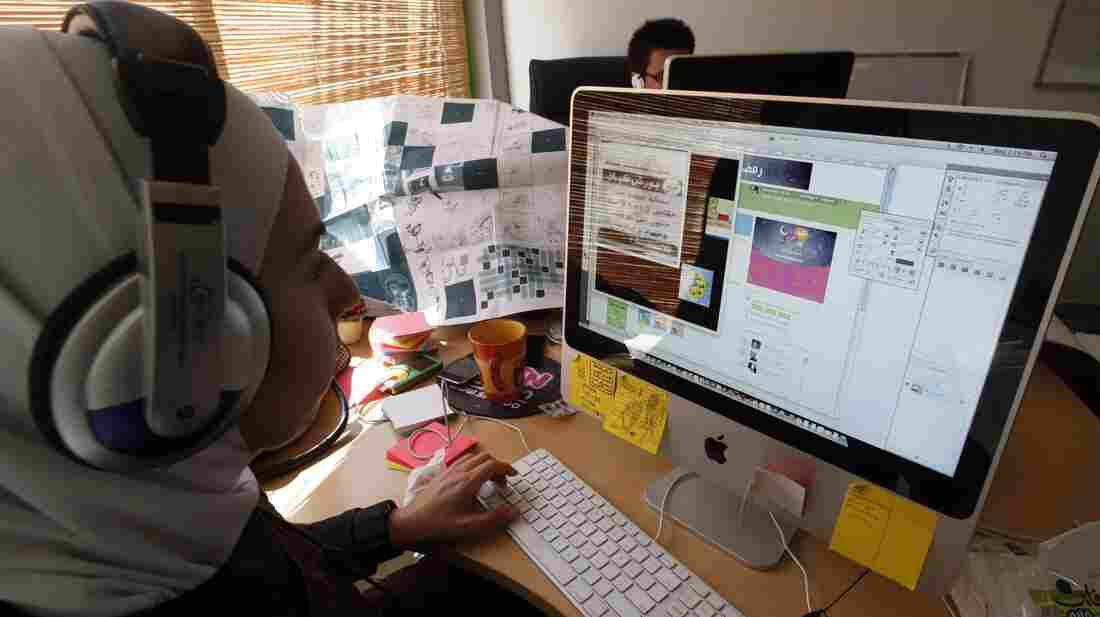 A Jordanian woman surfs the Web at an office in the Amman, Jordan, on Sept. 30, 2009. The country's government is under fire from media activists for blocking hundreds of websites across the kingdom.