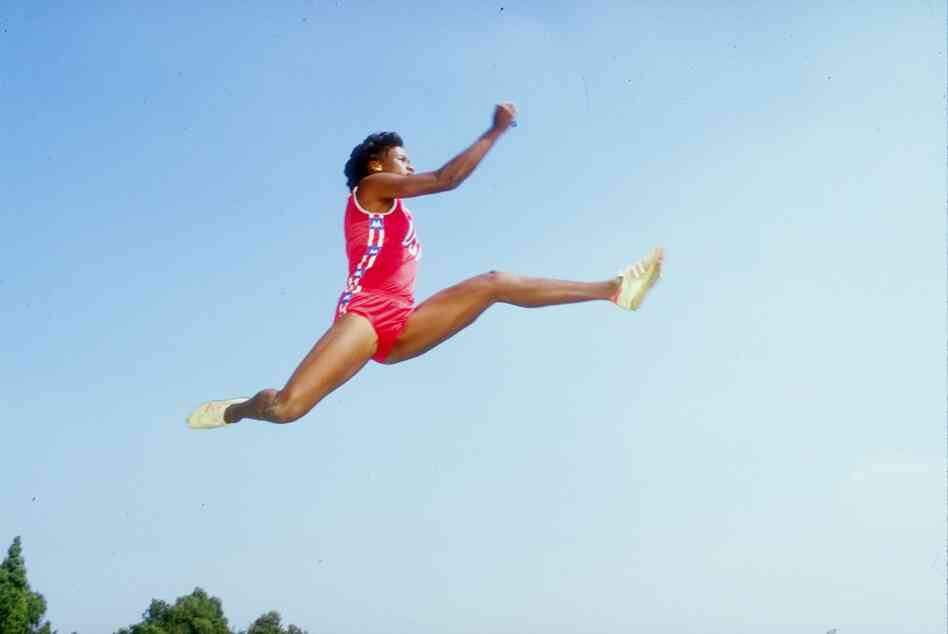 Jackie Joyner-Kersee, performing one of her famous long jumps in 1985.