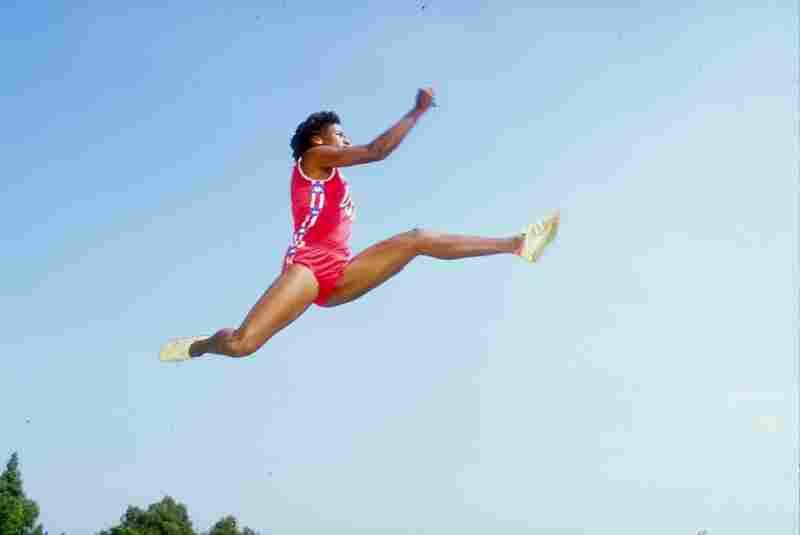 Jackie Joyner-Kersee, performing one of her famous long jumps in 1985.