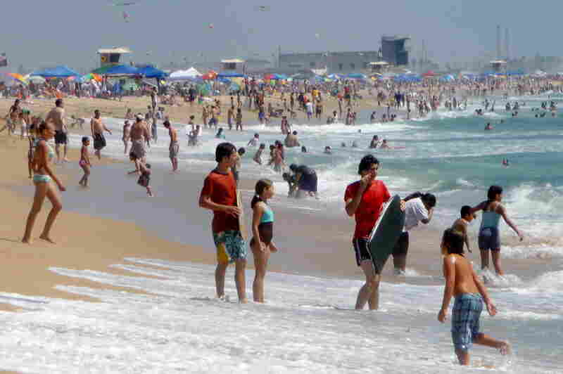 Summertime swimmers at Bolsa Chica Beach in Huntington Beach, Calif.