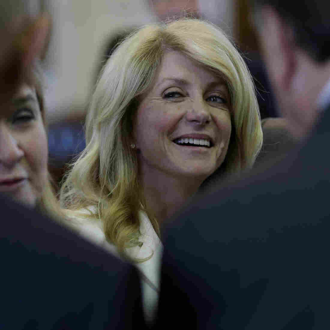 State Sen. Wendy Davis talks with fellow senators before her 11-hour filibuster attempt on Tuesday.