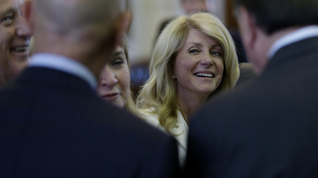 State Sen. Wendy Davis talks with fellow senators before her 11-hour filibuster attempt on Tuesday. (AP)
