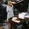 State Sen. Wendy Davis, a Fort Worth Democrat, dons pink tennis shoes during a Tuesday filibuster.