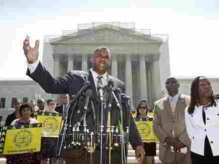 Ryan P. Haygood, director of the NAACP Legal Defense Fund, talks outside the Supreme Court on Tuesday about the court's opinion in Shelby County v. Holder.