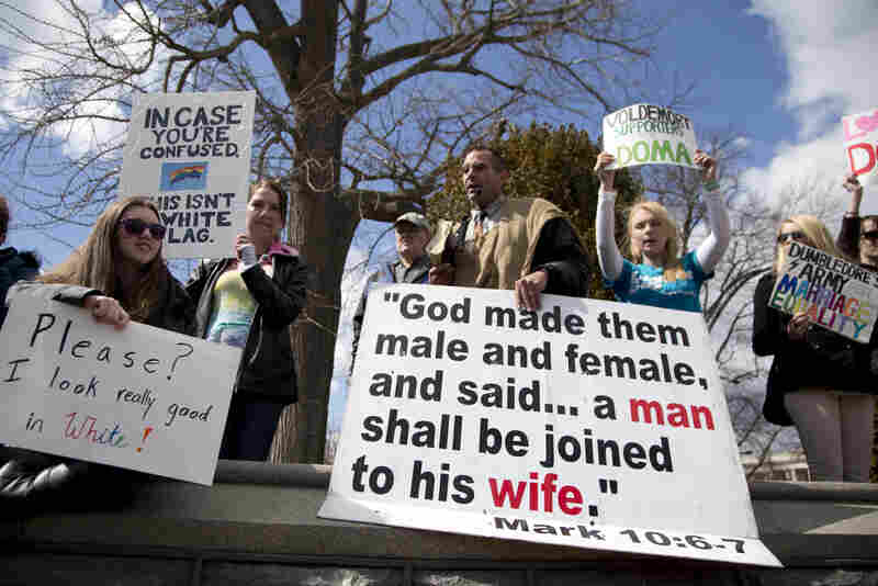 Allan Hoyle of North Carolina (center) protests gay marriage outside the Supreme Court.