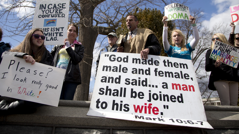 Allan Hoyle of North Carolina (center) protests gay marriage outside the Supreme Court. (AP)