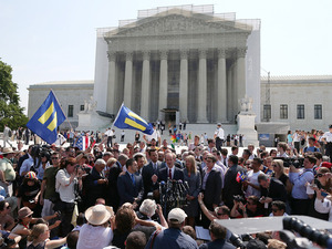 One of the attorneys in the California Proposition 8 case, David Boies (center), speaks outside the Supreme Court as he's surrounded by plaintiffs in the case, couples Paul Katami (from left) and Jeff Zarrillo, and Sandy Stier and Kris Perry.