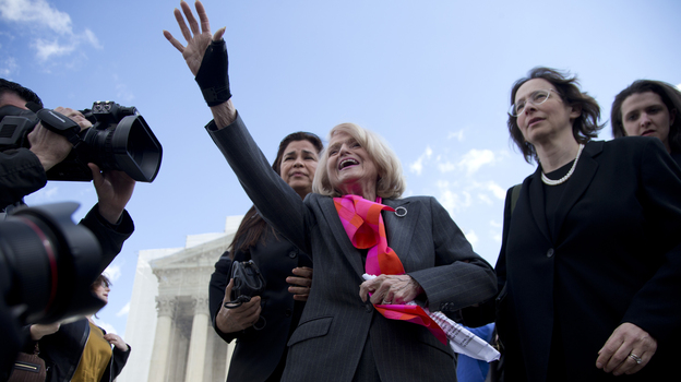 Plaintiff Edith Windsor of New York waves to supporters in front of the Supreme Court in Washington after the court heard arguments on her Defense of Marriage Act case. (AP)