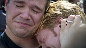 Michael Knaapen (left) and his husband, John Becker, embrace outside the Supreme Court after news of the justices' ruling. DOMA prohibited married gay couples from receiving the same federal benefits that straight couples are granted.