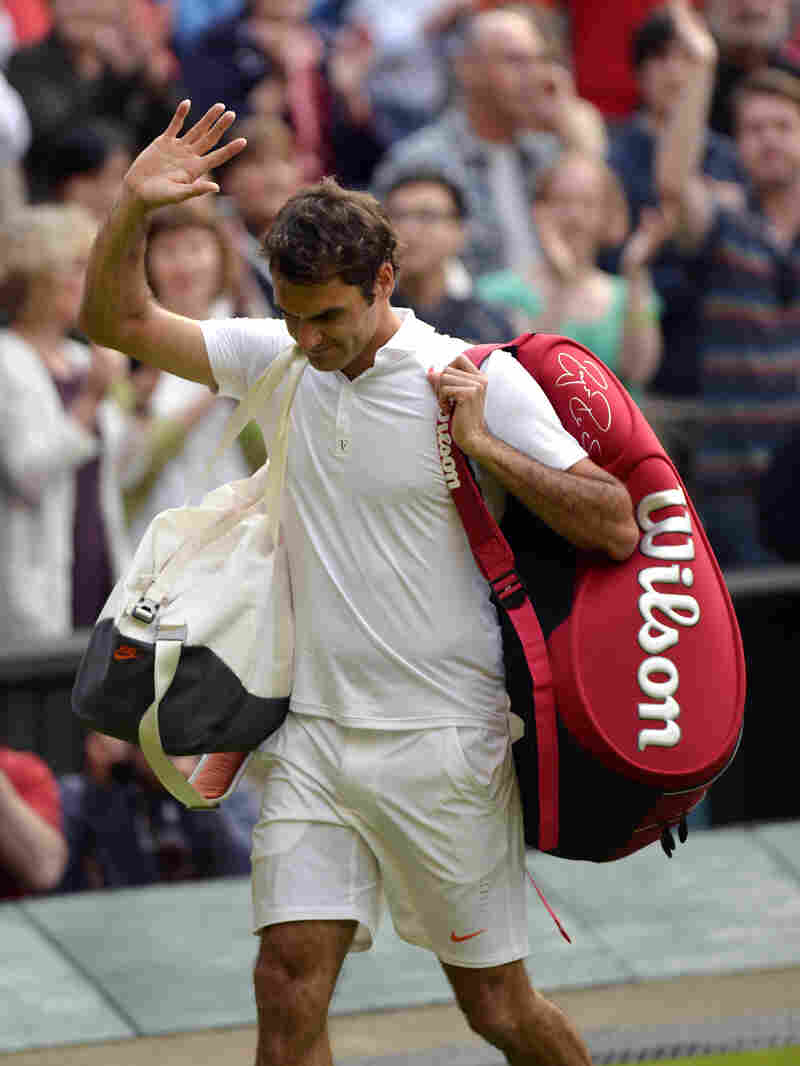 Seven-time Wimbledon champion Roger Federer leaves the court Wednesday, after losing in the second round to Ukraine's Sergiy Stakhovsky.