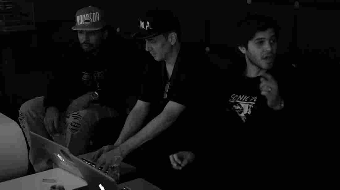 Mike Dean (center) backstage during the European leg of the Watch The Throne tour last year.
