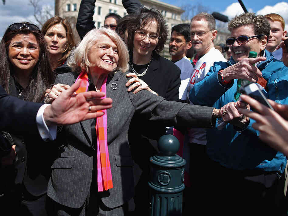 Edith Windsor is mobbed by journalists and supporters as she leaves the Supreme Court on March 27, when the court heard oral arguments in the case that challenged the constitutionality of the Defense of Marriage Act.
