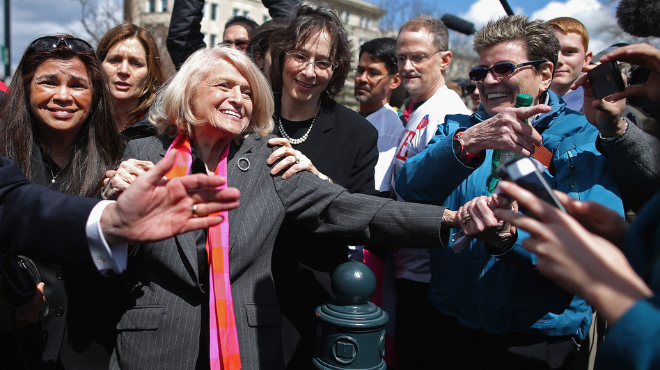 Edith Windsor is mobbed by journalists and supporters as she leaves the Supreme Court on March 27, when the court heard oral arguments in the case that challenged the constitutionality of the Defense of Marriage Act. (Getty Images)