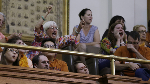 """Members of the gallery in the Capitol in Austin played a role in a vote on an abortion bill taking place after an official deadline. """"We will not allow the breakdown of decorum and decency to prevent us from doing what the people of this state hired us to do,"""" Gov. Rick Perry said Wednesday, in calling for a special session. (AP)"""