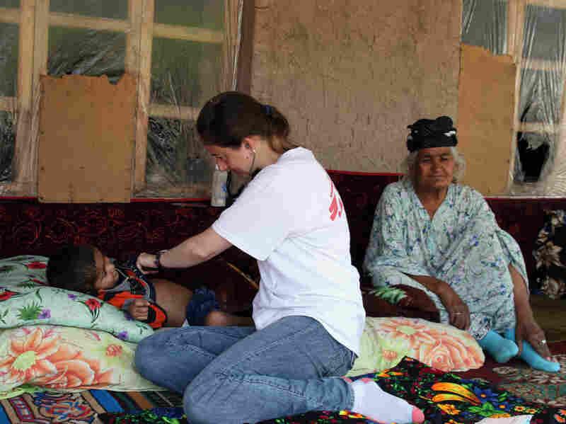 Nurse Tina Martin checks on Orion Qurbonaliev, 4, who has tuberculosis. Orion's grandmother, Kholbibi Abdulloeva, also has TB.