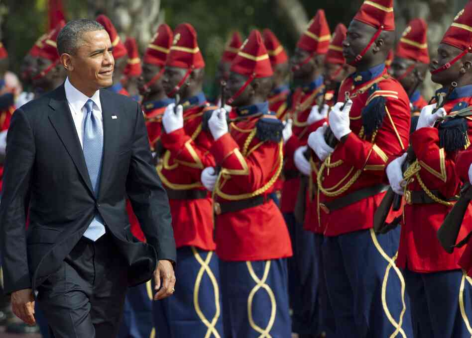 President Obama reviews an honor guard on Wednesday outside the presidential palace in Dakar, Senegal.